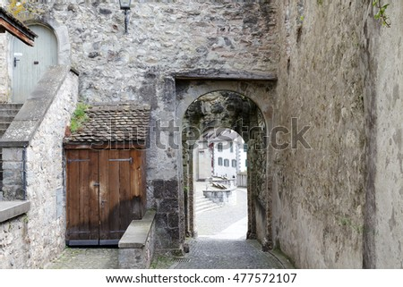 RAPPERSWIL, SWITZERLAND - MAY 10, 2016: Gate which is way out from the castle courtyard in the direction of city. This gate is part of the walls of the thirteenth-century castle.