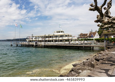 RAPPERSWIL, SWITZERLAND - MAY 10, 2016: MS Helvetia moored by the ferry terminal. The vessel was built in 1964 and was named Helvetia that is the female national personification of Switzerland