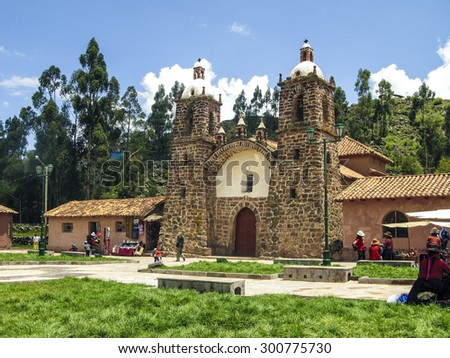 RAQCHI, PERU - JAN 19, 2015: people visit the church San Pedro de Cacha in Raqchi, Peru. The church of Raqchi is placed near the incan temple of Wiracocha.