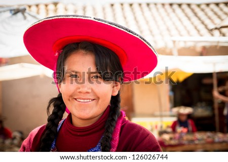 RAQCHI PERU -JANUARY 15: Quechua woman sells handcrafts at a market in Raqchi, Peru on January 15, 2013. Raqchi Ruins is a popular destination for tourism from all around the world. - stock photo