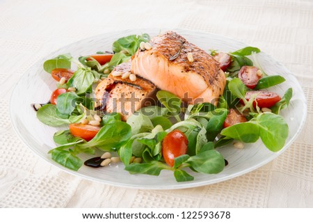 Rare fried salmon steaks in porcelain plate - stock photo