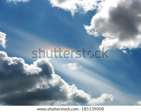 Rare natural phenomenon - rainbow between clouds over a head - stock photo