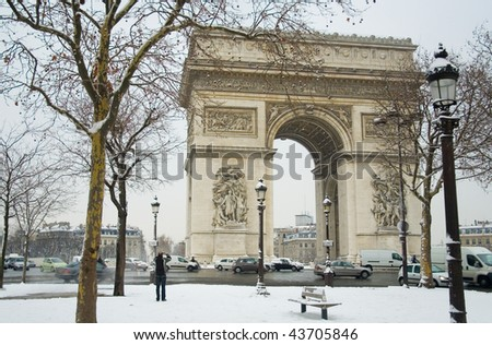 Rare snowy day in Paris. Arc de Triomphe and lots of snow - stock photo