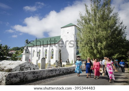RAROTONGA - JUNE 10 2013:Cook Islanders women come out the CICC church after Sunday service.The dominant religion in the Cook Islands is Christianity since the first missionaries arrived in 1821.