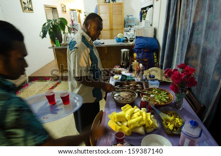 RAROTONGA - SEP 16:Fijian men eats traditional food at home on Sep 16 2013.Fijian people are the major indigenous people of the Fiji Islands since 3,500 years ago. - stock photo