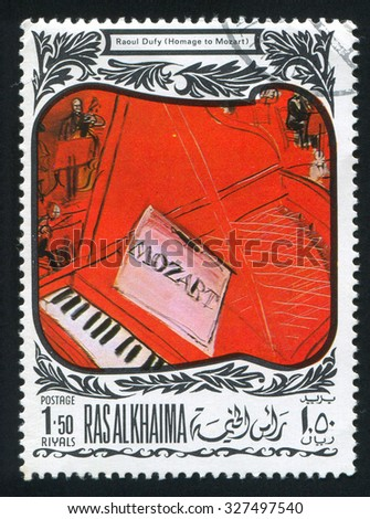 RAS AL KHAIMA - CIRCA 1972: stamp printed by Ras al Khaima, shows Homage to Mozart by Raoul Dufy, circa 1972 - stock photo