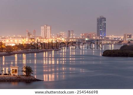 Ras Al Khaimah creek at dusk. Emirate of Ras Al Khaimah, United Arab Emirates - stock photo