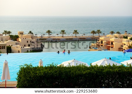 RAS AL KHAIMAH, UAE - SEPTEMBER 7: The tourists enjoying their vacation at luxury hotel on September 7, 2013 Ras Al Khaimah, UAE. Up to 10 million tourists have visited UAE  in year 2013. - stock photo