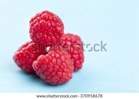 Rasberrys on a wooden table - stock photo