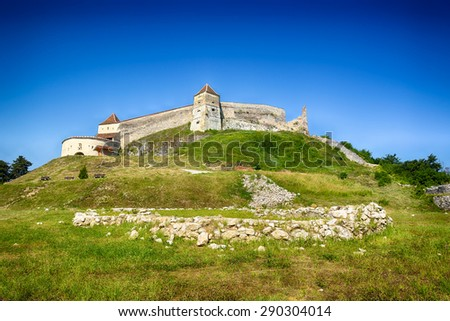 Rasnov Citadel (Romanian: Cetatea Rasnov, German: Rosenauer Burg) is a historic monument and landmark in Romania. - stock photo