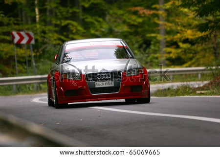 RASNOV, ROMANIA - OCT. 1: Gollner Heinz drives a AUDI RS 4 car during Rally of Romania 2010 championship on October 1, 2010 in Rasnov, Romania.