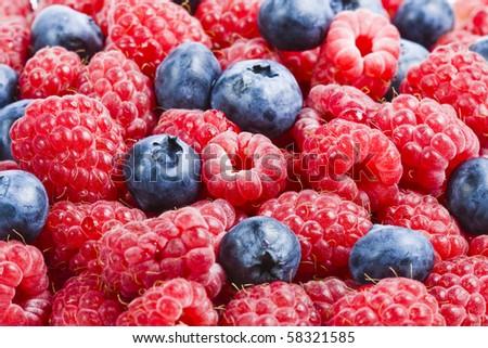 Raspberries and blueberries , background - stock photo