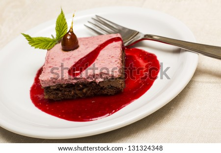 Raspberries and chocolate cake. White background