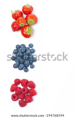 raspberries, blueberries and strawberries, top view, isolated on white - stock photo