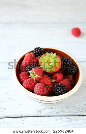 Raspberries, blueberries and strawberry in a bowl, healthy food