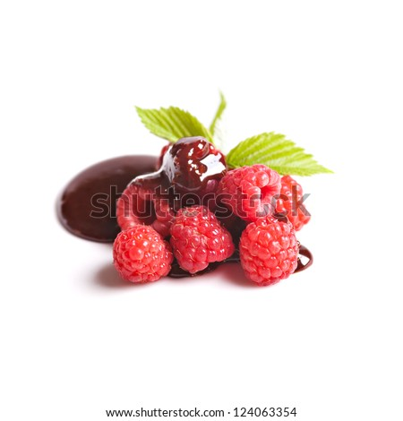 Raspberries fruits with chocolate isolated over white - stock photo
