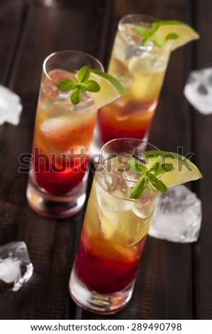 Raspberries lemonchello shots with ice and lime - stock photo