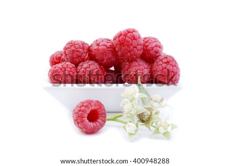 Raspberries. Raspberries isolated on white background. Ripe red raspberries on white. Raspberries with green leaves. Raspberries in white bowl. Delicious fresh raspberries and raspberries flowers. - stock photo
