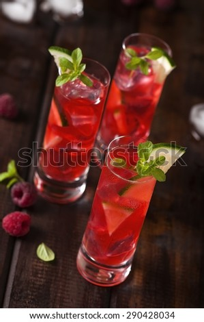 Raspberries shots with ice and lime - stock photo