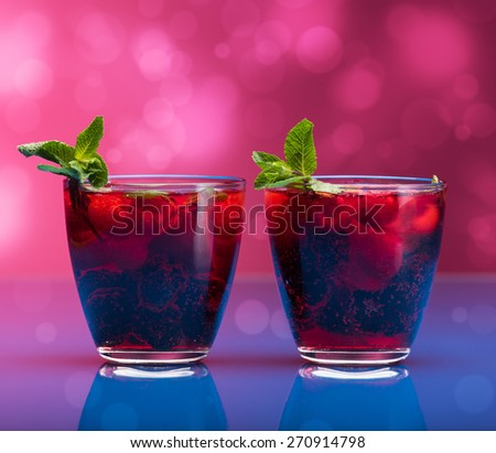 Raspberry and blackberry cocktail with mint garnish. Studio shot - stock photo