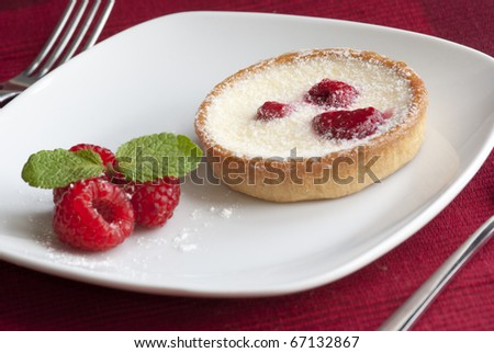 Raspberry and custard tart with mint
