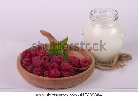raspberry and milk in bowl isolated on white background - stock photo
