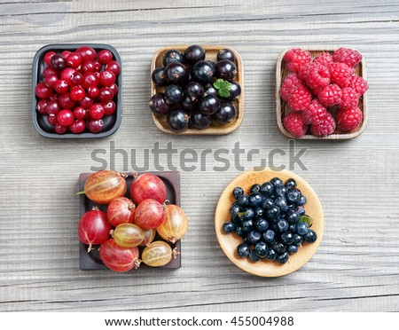 Raspberry, Bilberry, Gooseberry, Cranberry and Currant. Harvest Concept. Top view, high resolution product. - stock photo