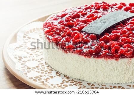 raspberry birthday cake with coconut on plate - stock photo
