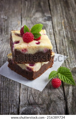 raspberry cheesecake brownies on a rustic wooden background - stock photo