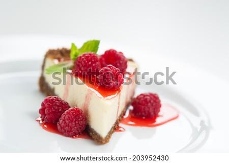 Raspberry Cheesecake on a plate - stock photo