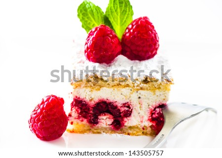 raspberry cheesecake on white plate with frech mint on the top