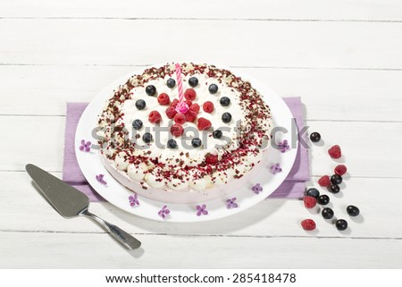 Raspberry-cream cake with raspberries and blueberries