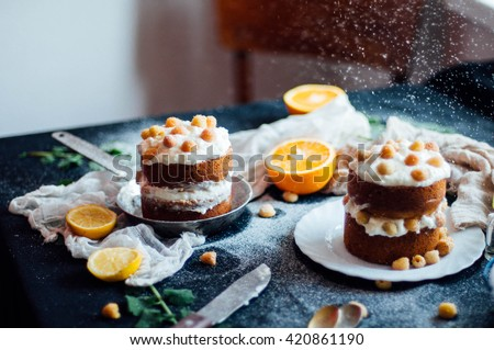 Raspberry Cupcake. Closeup of a cream cake covered with raspberries and gelatin. Raspberry Cake for holidays. Sponge cake with sour cream and raspberry. Cake with cream and berries. Contry kithen styl - stock photo