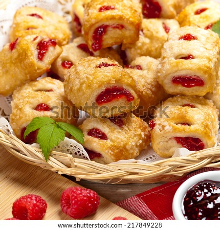 Raspberry filled pastries with sugar sprinkles. Selective focus. - stock photo