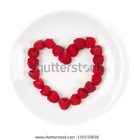 Raspberry Heart isolated on white - stock photo