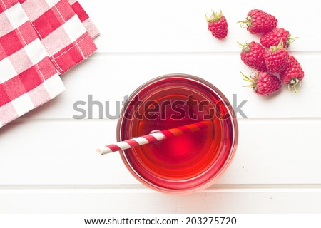 raspberry juice on white table - stock photo