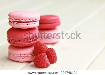 Raspberry macarons on a white table with fresh fruits  - stock photo