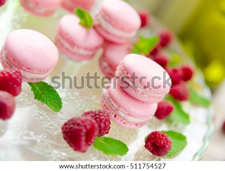 Raspberry macarons with fresh fruits and mint