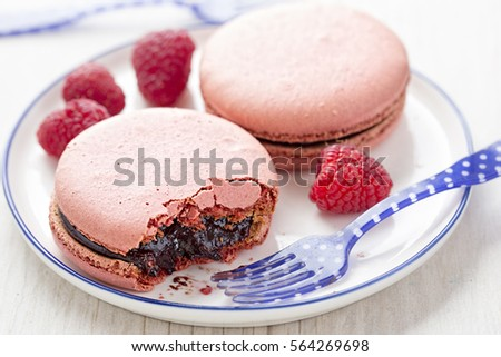 Raspberry macaroons with chocolate, raspberry and summer fruits centre