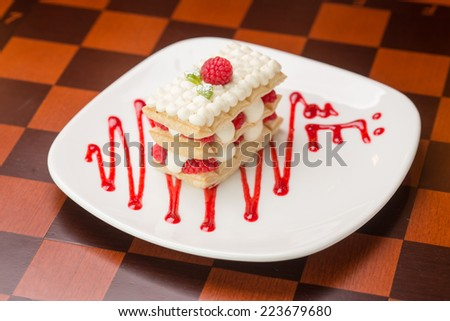 Raspberry mille feuille dessert on the table - stock photo