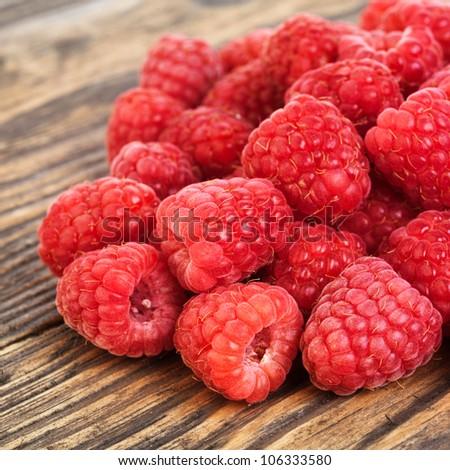 Raspberry on wood background selective focus. Fresh organic food. - stock photo