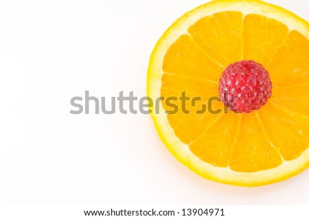 raspberry over a slice of orange