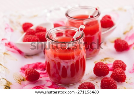 Raspberry smoothie with fresh fruits - stock photo