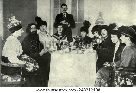 Rasputin, the favorite of the Russian Empress, with women admirers, 1911. His ability to ease the Czarevich's hemophilia made he became an influential figure in the Russian court.