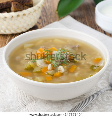 rassolnik soup in a bowl on the table close-up - stock photo