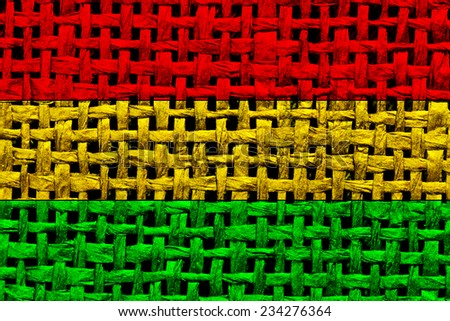 Rasta color checkered table cloth texture. - stock photo