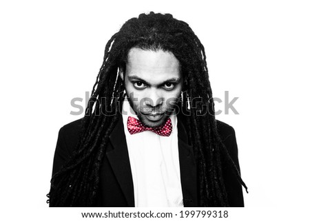 rasta man wearing suit and bow black and white portrait - stock photo