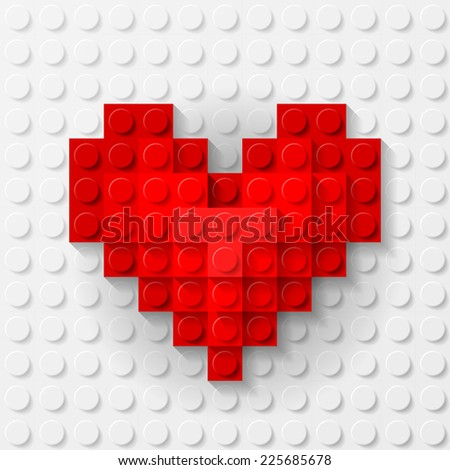 Raster version. Plastic red heart on white background made of construction kit  - stock photo