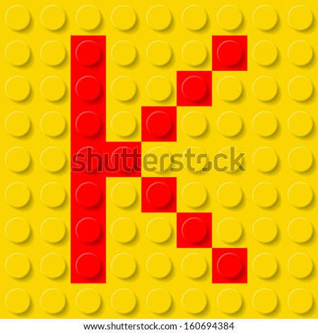 Raster version. Red letter K in yellow plastic construction kit. Typeface sample. - stock photo