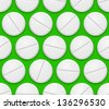 Raster version. Seamless texture realistic pills on  green background. - stock photo